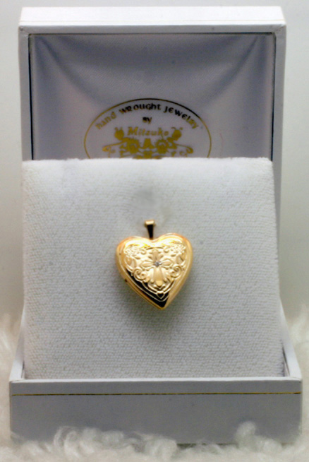 Gold engraved locket, rose and cross design