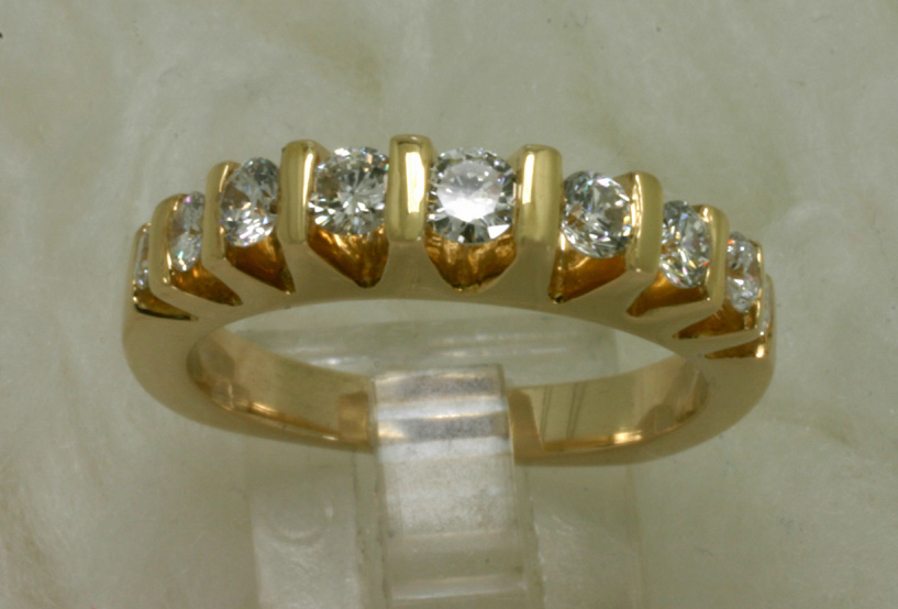 14 Karat yellow Gold Ring with Channel set diamond